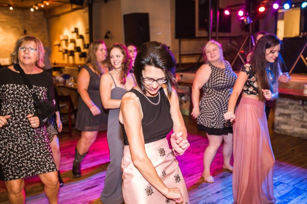 wedding guests on the dance floor dancing to milwaukee underground productions DJ Service