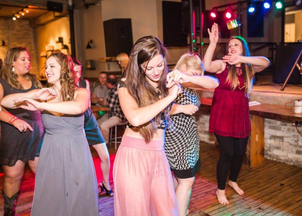 guests dancing on the dance floor, doing te wobble