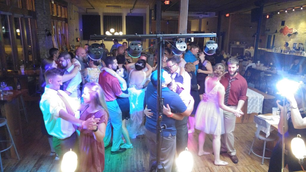 Wedding Guests slow dancing at Anodyne Coffee In Bay View Wisconsin Wedding Event Space DJ Services from Milwaukee Underground Productions